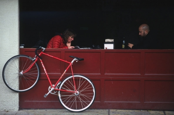 couple at a cafe with red bicycle-Kensington