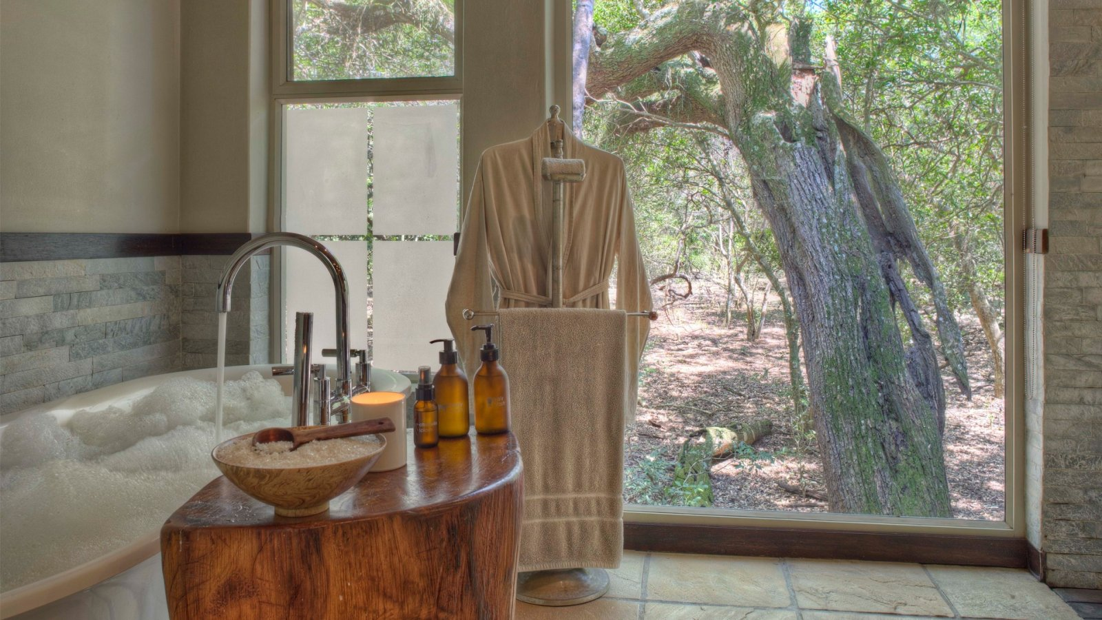 bathroom-overlooking-forest-at-andbeyond-phinda-forest-lodge-on-a-luxury-safari-in-south-africa.jpg