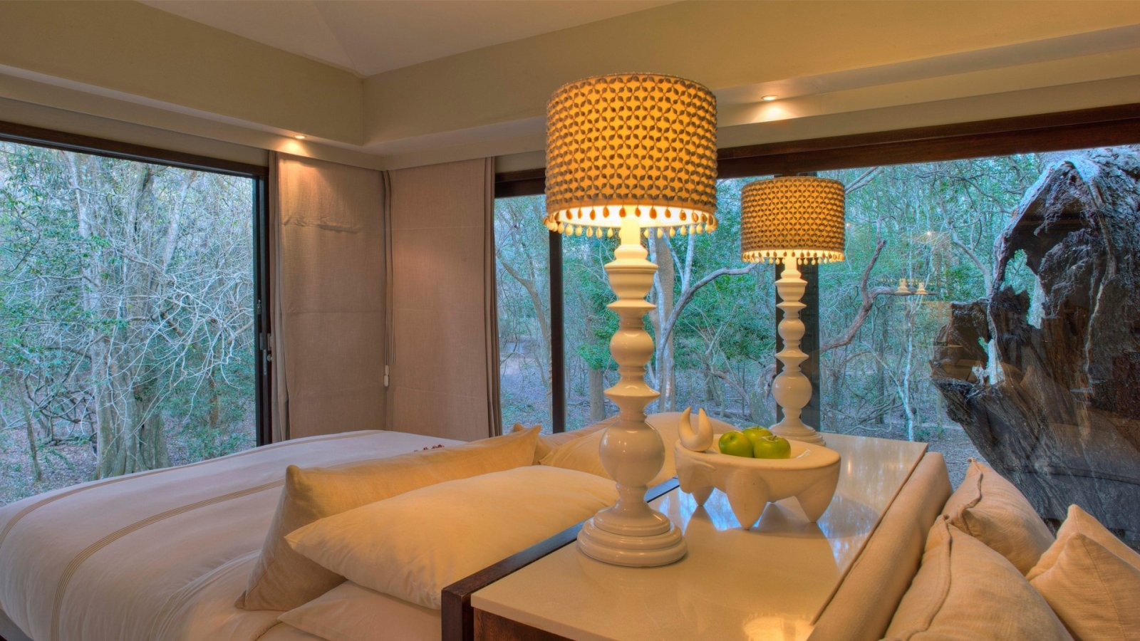 glass-windows-surround-bedroom-at-andbeyond-phinda-forest-lodge-on-a-luxury-safari-in-south-africa.jpg